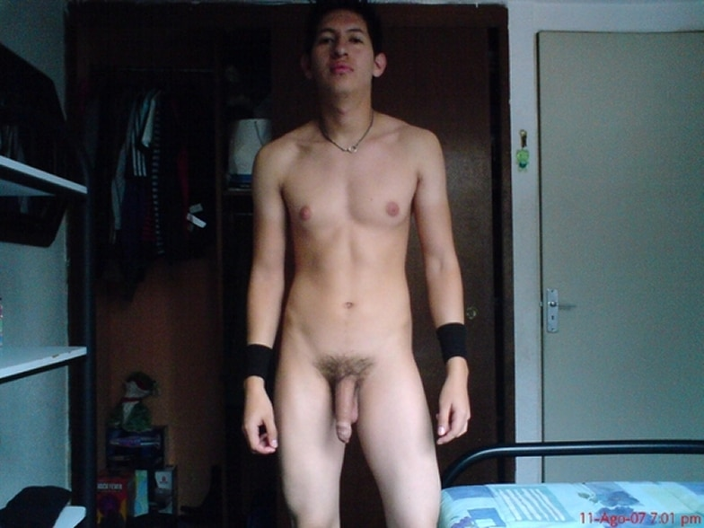 Nude Teen Boy Posing For The Camera